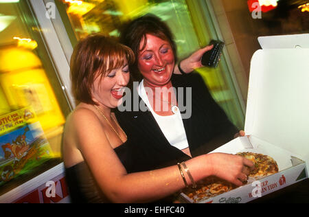 Mother and daughter getting a takeaway pizza after a night out on The Big Market in Newcastle. - Stock Image