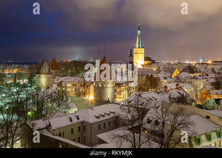 Winter evening in Tallinn old town with St Olaf's church towers above the city. - Stock Image