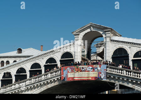 Venice, Italy. 25th Feb, 2014. A view of the Rialto Bridge which crosses the Grand Canal. A sign is placed at the centre announcing the Carnivale. Venice Carnivale Credit:  MeonStock/Alamy Live News - Stock Image