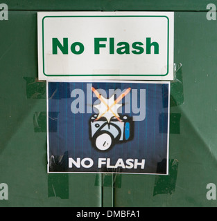 Sign warning not to take any photos using flash - Stock Image