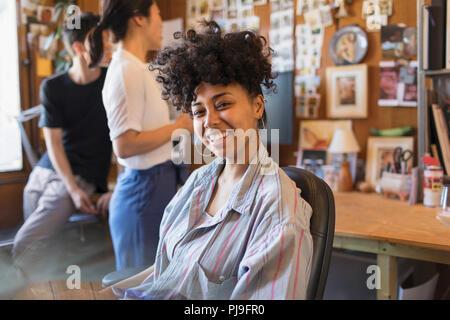 Portrait smiling, confident creative businesswoman in office - Stock Image