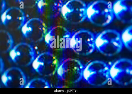 Light emitting diodes nacro for LED display. Digital LED screen blue background - Stock Image