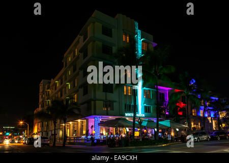 The neon-illuminated Art Deco facade of SOBE's historic Winter Haven Hotel along Deco Drive on Miami's South - Stock Image