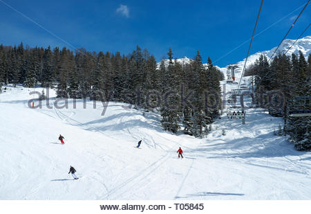 Skiers make their way down hill at the ski resort in Sainte-Foy-Tarentaise, Auvergne-Rhône-Alpes region in south-eastern France. - Stock Image