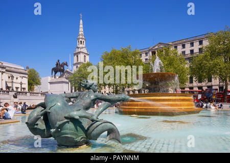 Fountain, Statue of King George iv and spire of St Martin's-in-the-Fields, Trafalgar Square, Whitehall, London, England - Stock Image