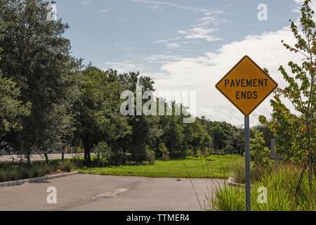 Roadway Asphalt Pavement Ends - Stock Image
