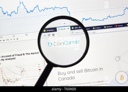 MONTREAL, CANADA - APRIL 26, 2019: Coincorner cryptocurrency digital assets exchange logo and home page on a laptop screen under magnifying glass. - Stock Image