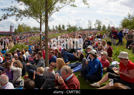 Spectators watching giant outdoor screens at Park View West on a sunny day in sunshine at Olympic Park, London 2012 - Stock Image