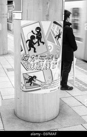 Tokyo Metro warning sign - Stock Image