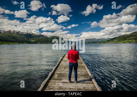 Mature female enjoying the landscape of Gloppen, Norway - Stock Image