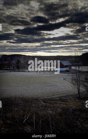 Frost covered rural landscape under a cloudy sky in Anundsjoe, Sweden. - Stock Image