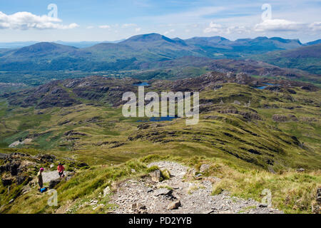 View from Cnicht mountain to distant Moel Hebog and Nantlle Ridge mountains on skyline in Snowdonia National Park. Croesor Gwynedd Wales UK Britain - Stock Image