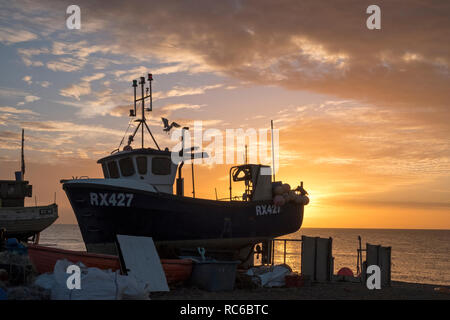 Hastings, East Sussex. 14th Jan, 2019. UK Weather: Fishermen bring in the night's catch of fish. Hastings has one of the largest beach-launched fishing fleets in Europe. - Stock Image