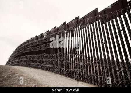 US-Mexico international border: Layers of Concertina are added to existing barrier infrastructure along the U.S. - Mexico border near Nogales, AZ, on February 4, 2019. See more information below. - Stock Image