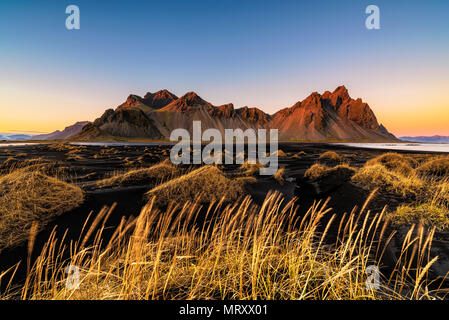 Stokksnes, Hofn, Eastern Iceland, Iceland. Vestrahorn mountain and the black sand dunes at sunset. - Stock Image