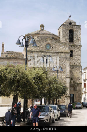The hilltop town of Miglionico in Basilicata, Southern Italy showing the mother church of Santa Maria Maggiore and the main street. - Stock Image