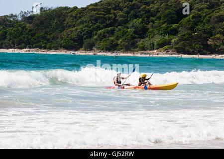 Sea Kayaking at Byron Beach in Byron bay. - Stock Image