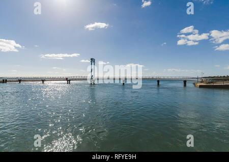 Pedestrian bridge from Pedras d'el Rei to Praia do Barril beach, crossing Ria Formosa, Algarve, Portugal. - Stock Image