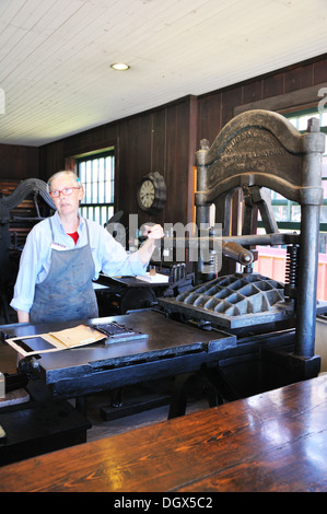 Old printing press demonstration at Mystic Seaport, Connecticut, USA - Stock Image