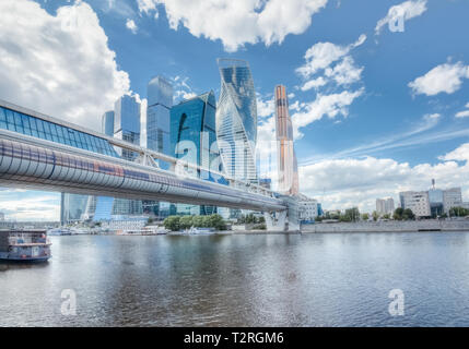 City landscape with skyscrapers Moscow city on a river under a blue sky with cumulus clouds - Stock Image
