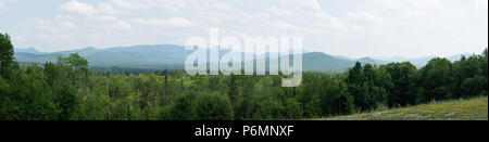 A panorama landscape view of the Adirondack Mountain range east of Indian Lake, NY USA on a hot humid summer day. - Stock Image