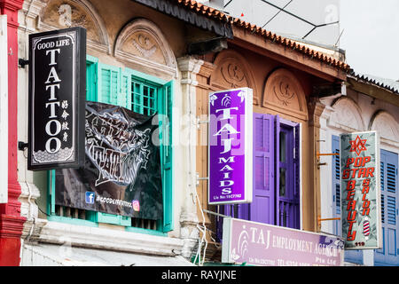 Singapore - 22nd December 2018: Shop signs in Little India. The area is so calles because of number of Indian shops and restaurants, - Stock Image