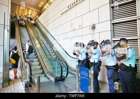 Hong Kong, China - June 21th, 2019. Protesters block police headquarters and demand the release of protesters arrested at a previous demonstration. Protesters also demand that Chief Executive Carrie Lam to step down. Credit: Gonzales Photo/Alamy Live News - Stock Image