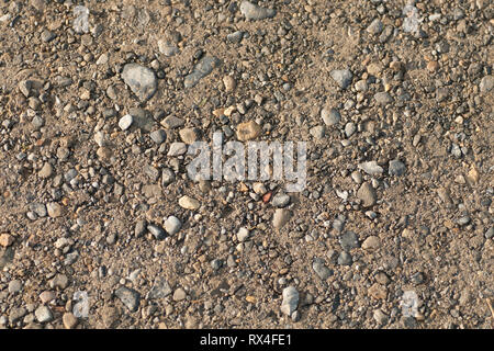 Close-up gravel road surface - Stock Image