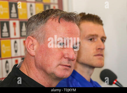 Windsor Park, Belfast, Northern Ireland. 20 March 2019. Northern Ireland manager Michael O'Neill (l) and captain Steven Davis at today's press conference in Belfast. Northern Ireland play Estonia at Windsor Park tomorrow  evening in their opening UEFA EURO 2020 Qualifying game. Credit: David Hunter/Alamy Live News. - Stock Image