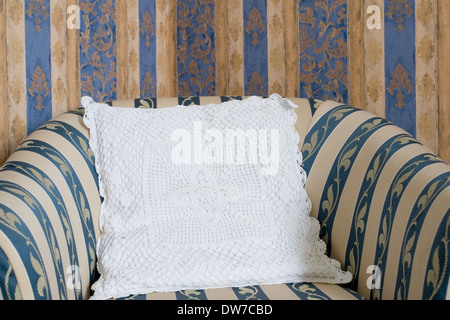 Armchair with lace pillow - Stock Image