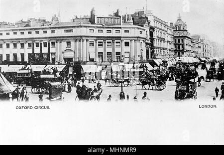 Busy scene at Oxford Circus, Central London, with pedestrians and traffic.     Date: circa 1900 - Stock Image