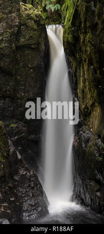 Braids of water plunging into the pool beneath Stanley Force, Eskdale, Cumbria, UK - Stock Image
