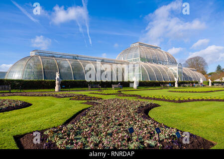Kew gardens palm house, England, UK. Large old cast iron greenhouse. - Stock Image