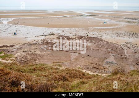 Dangerous soft sand forming quicksand seen from above on the beach at low tide. Lligwy, Isle of Anglesey, North Wales, UK, Britain, Europe - Stock Image
