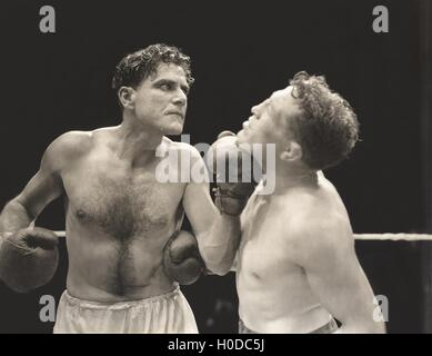 A punch to the jaw - Stock Image