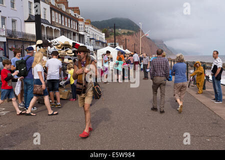 Crowds on sea front promenade during Sidmouth Folk Festival 2014. - Stock Image