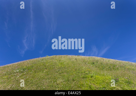 Green Hill with Blue Sky - Stock Image