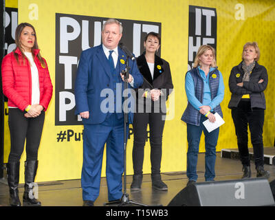 London, UK. 23rd Mar, 2019. Ian Blackford SNP MP leader speaking with Anna Soubry TIG MP , Dr Rosena Allin-Khan labour MP,  Caroline Lucas Greens MP, Justine Greening Conservative MP  People's Vote March and rally, 'Put it to the People.' Parliament Square London Credit: Prixpics/Alamy Live News - Stock Image