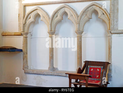 Sedilia, a set of three recessed seats in the chancel south wall by the altar in the Church of St Margaret at Cley-next-the-Sea, Norfolk, England, UK. - Stock Image