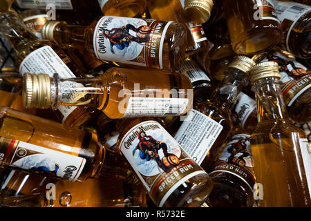 A basket full of miniature bottles of Captain Morgan Original Spiced Rum for sale in a liquor store. - Stock Image