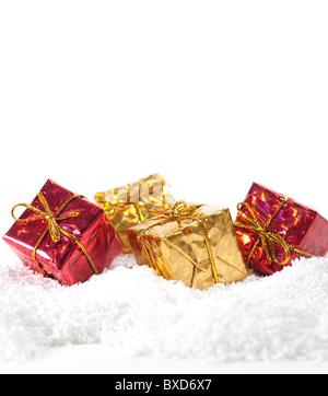 Christmas gifts and snow background - Stock Image