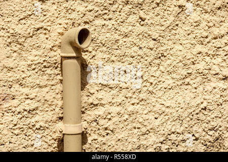 External Natural Gas Meter With Some Yellow Steel Pipes on Wall . - Stock Image