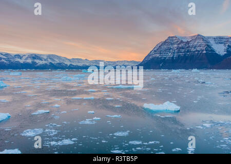 Greenland, Scoresby Sund, Gasefjord. Wind-rippled water and bergy bits in a fjord. - Stock Image