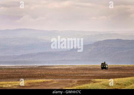 All terrain vehicle driving on safari in Africa. - Stock Image