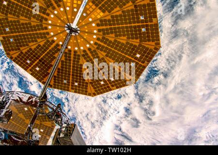 Clouds below the spaceship. The beauty in nature of our planet Earth seen from the International Space Station (ISS). The image is a public domain han - Stock Image