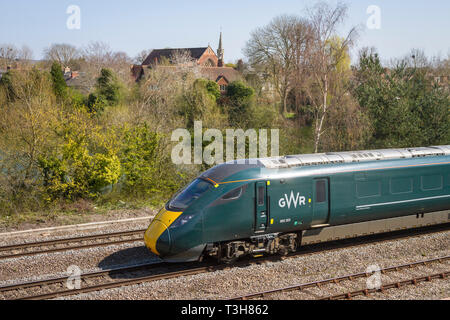 A British Rail Class 800 high speed train at Hinksey, Oxford with St. John The Evangelist Church in the background - Stock Image