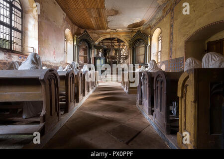 A collection of plaster ghosts, part of an art project, in the abandoned St George's church in Czech Republic. - Stock Image