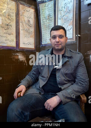 Meybod, Iran - March 6, 2017 : iranian guy sitting in a local cafè - Stock Image