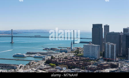 Views towards Oakland Bay bridge and part of financial district, downtown San Francisco, from the historic Coit - Stock Image