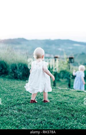Girl walking on lawn - Stock Image